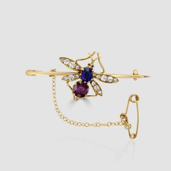 Bee brooch with sapphire and rubies
