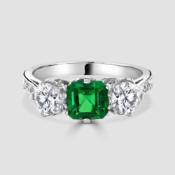 Three stone emerald diamond ring