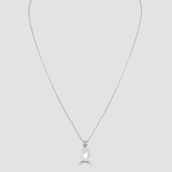 Drop shape pearl and diamond pendant