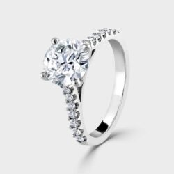 Platinum solitaire with diamond shoulders
